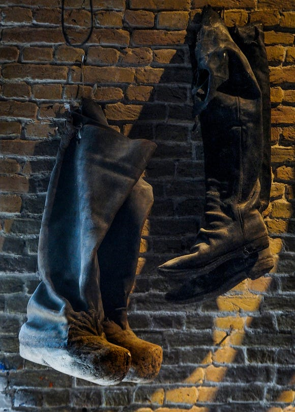 A pair of wooden work boots.