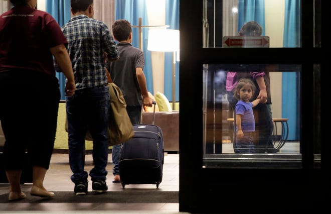 In this Monday, July 23, 2018, file photo, immigrants seeking asylum who were recently reunited arrive at a hotel, in San Antonio. A federal judge says he will give the Trump administration six months to identify children who were separated from their families at the U.S.-Mexico border early in the president's term. U.S. District Judge Dana Sabraw said Thursday, April 25, 2019, in San Diego that it was important to set a deadline for finding potentially thousands of children who were separated between July 1, 2017, and June 25, 2018. (AP Photo/Eric Gay, File)