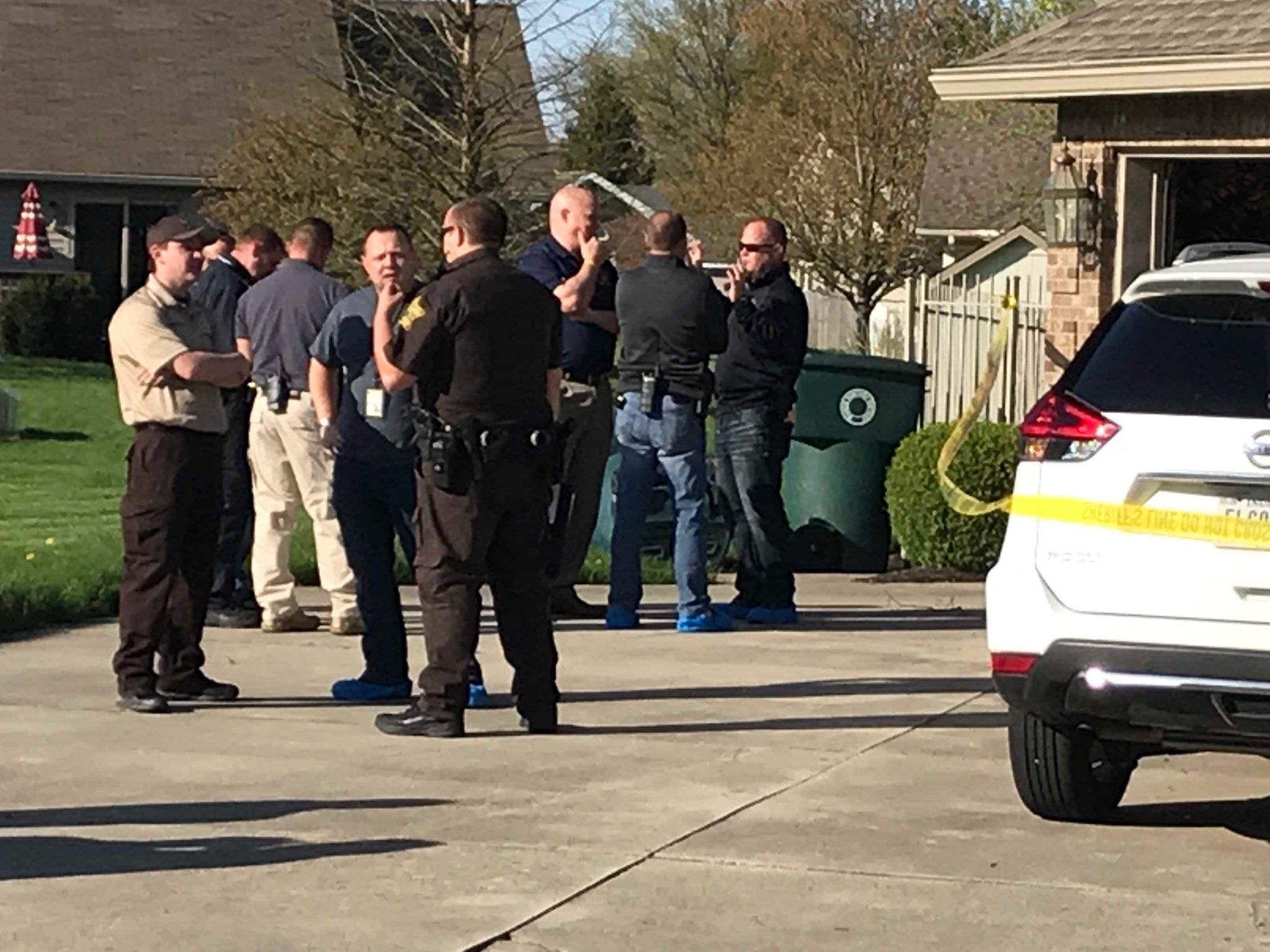The scene at a home in the 5000 block of Timothy Way in Muncie, where authorities investigate a reported murder-suicide on Sunday, April 28.