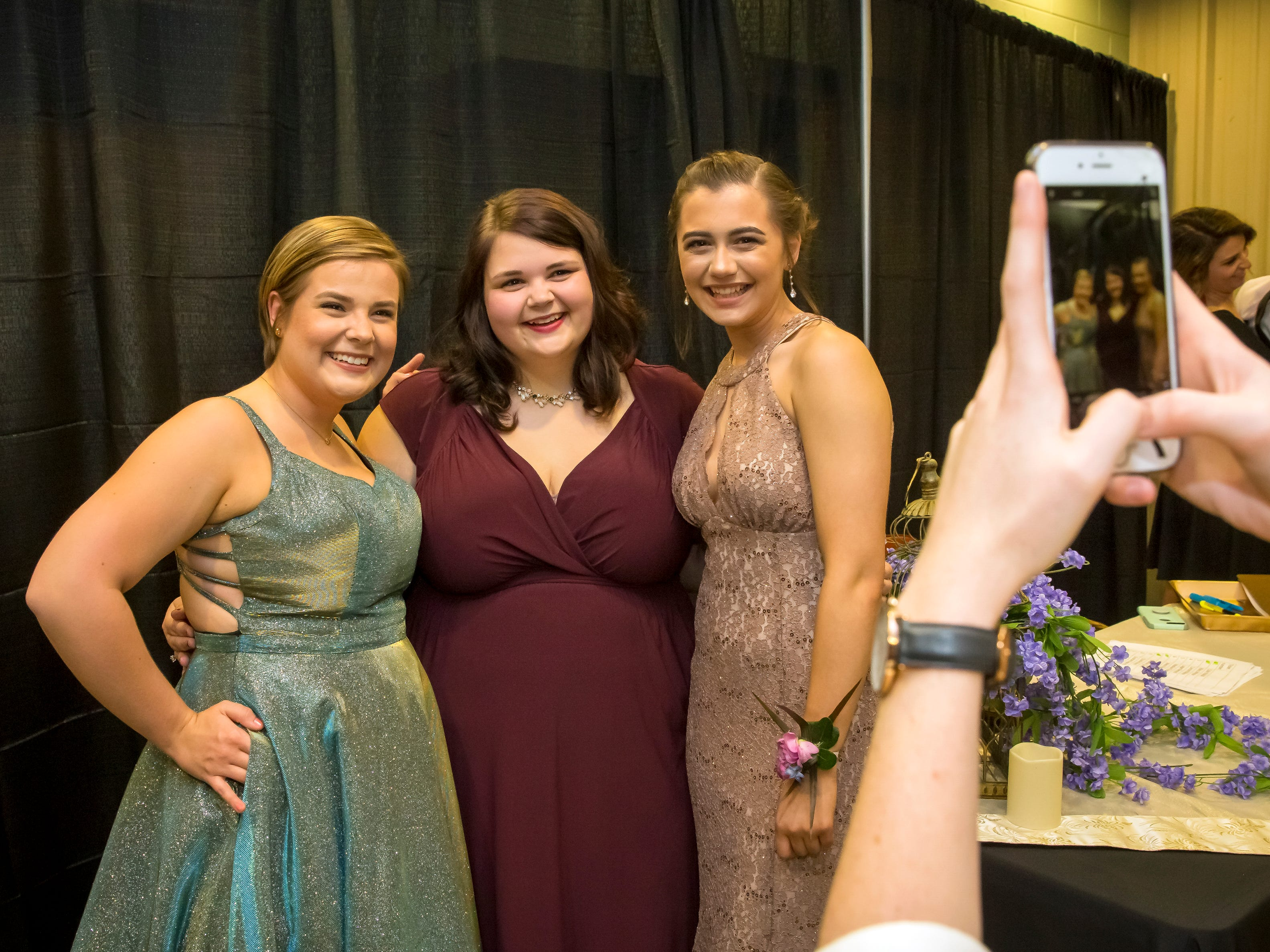 McKinley Green, Mahala Greb-Mills and Bridget Carlson arrive at the Oakland High School prom held at Lane Agri-Park Saturday, April, 27, 2019 in Murfreesboro .