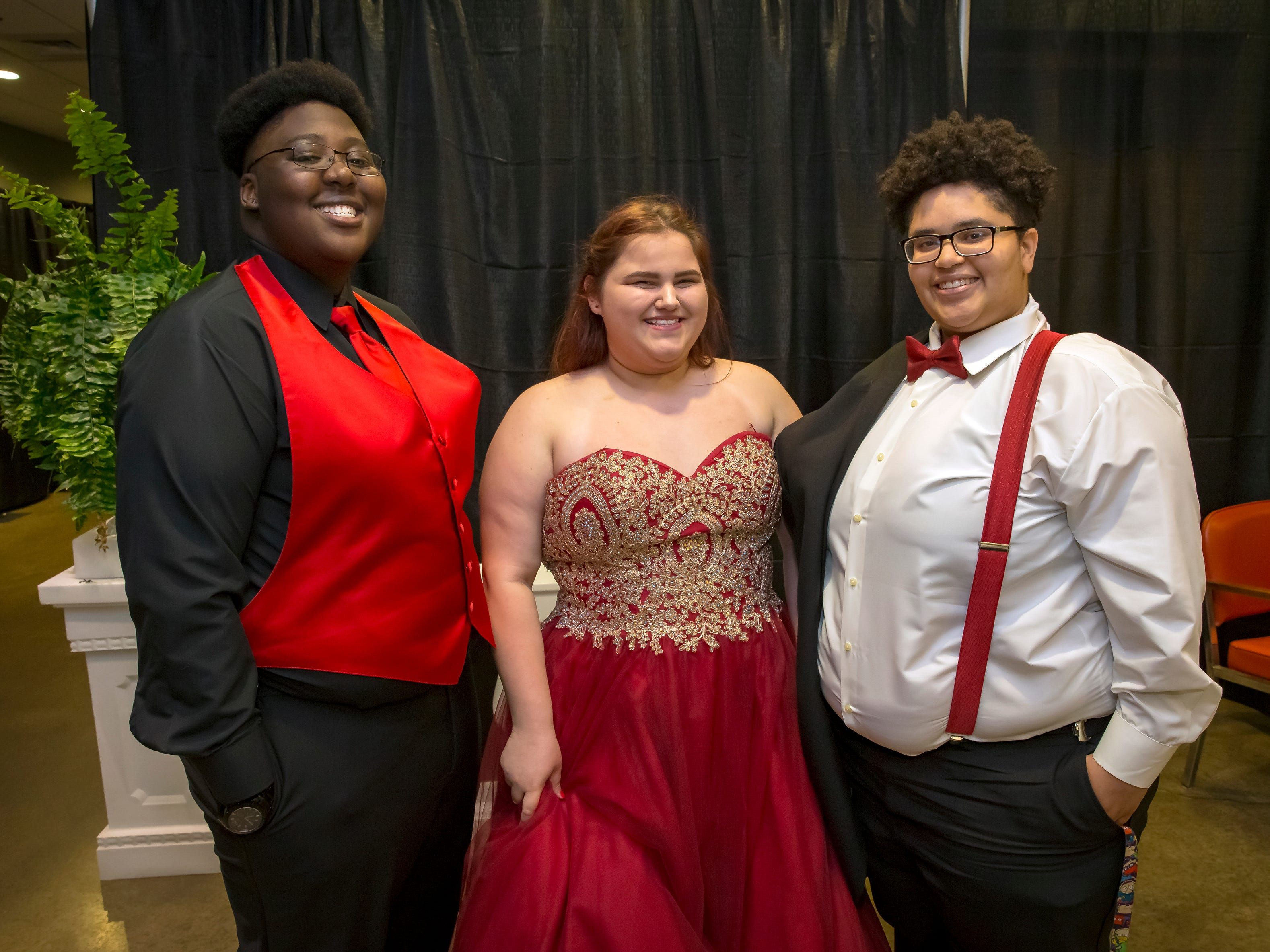 Akaila Hugley, Madison Lands and Calissa Wilcox arrive at the Oakland High School prom held at Lane Agri-Park Saturday, April, 27, 2019 in Murfreesboro .