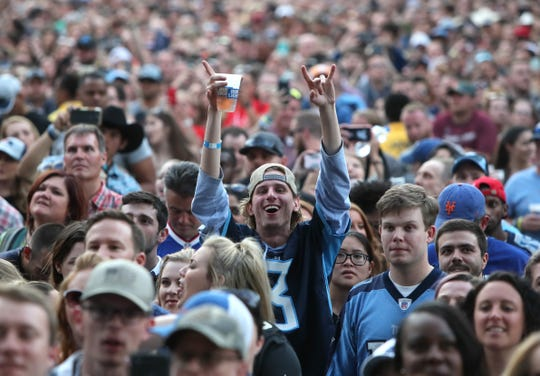 Fans cheer on Dierks Bentley as he performs during the culmination of the NFL draft on Lower Broadway in downtown Nashville on Saturday, April 27, 2019.