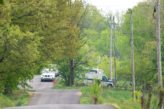 Authorities investigate where seven people were found dead in two neighboring homes in Westmoreland, Tenn., over the weekend of April 27.