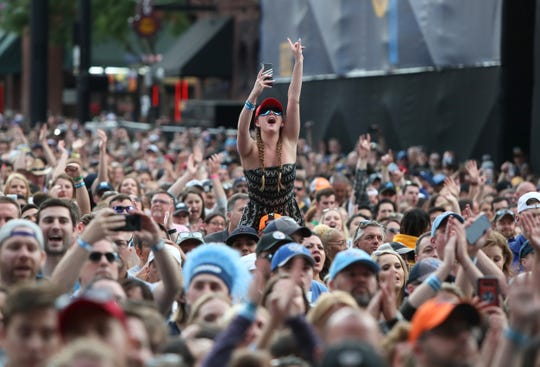 Fans cheer on Dierks Bently as he performs during the culmination of the NFL draft on Lower Broadway in downtown Nashville on Saturday, April 27, 2019.