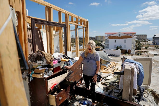 Candace Phillips sifts through what was her third-floor bedroom after returning to her damaged home in Mexico Beach, Fla., on Oct. 14, 2018, in the aftermath of Category 5 Hurricane Michael.