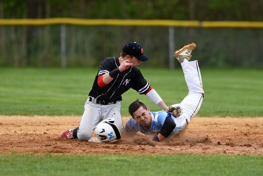 Mahwah's Garret Kurtz slides in safe at second as Northern Highlands' Issac Springer tries to get the out.