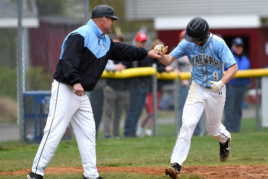Mahwah's Kyle Teel gets a fist bump from Coach Jeff Remo as he makes his way from third to home.