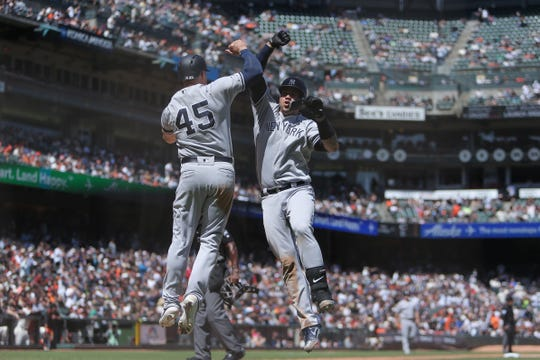New York Yankees catcher Gary Sanchez (24) celebrates with first baseman Luke Voit (45) after hitting a two run home run during the sixth inning against the San Francisco Giants at Oracle Park.