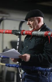 J. Barrett Wolf reads his poems, at Ike's & Randy's Boxing Gym, during Voices of Poetry - With Gloves Off.  Sunday, April, 28, 2019