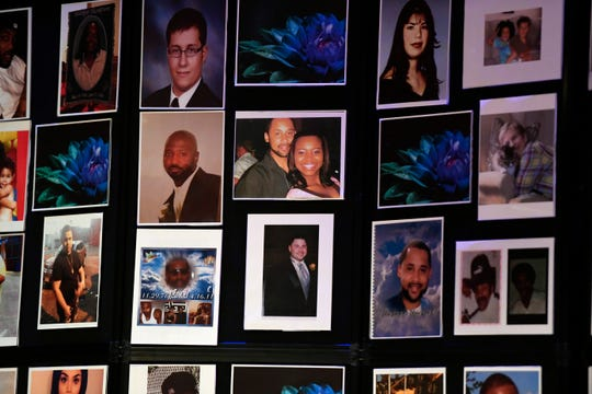 Photos of the victims of violent crimes on display during the annual candlelight vigil for crime victims on Sunday, April 28, 2019, in Paterson.