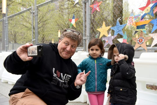 Jeff Parness, founder of Stars of HOPE, poses for a selfie with Amy and Desmond Heppolette, after the youngsters hung stars on the construction fence surrounding the 9/11 Memorial Glade. The stars will be presented to 9/11 first responders, family members, health advocates and others during the Glade dedication May 30, 2019, the 17th anniversary of the official end of the recovery mission at Ground Zero.