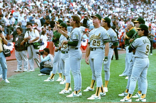 Members of the Oakland Athletics stand and stare as Candlestick Park-goers leave the stadium in the wake of the major earthquake that struck Northern California just before Game 3 of the World Series against the San Francisco Giants in this Oct. 17, 1989.