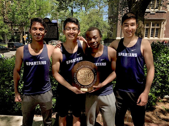Paramus' 4-x-400 relay team at Penn Relays, from left, Ryan Fernando, Gabe Pineda, Dennis Hemans, and Dan Stipanov went wire-to-wire and won its heat by more than 20 meters to earn the plaque.