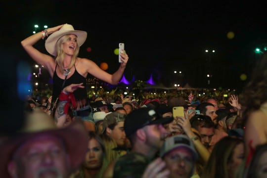 Thousands watch Sam Hunt perform at the Stagecoach country music festival, Indio, Calif., April 27, 2019.
