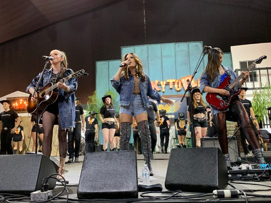 Honey Country sings 'Country Strong' in the Honky Tonk Dance Hall during the Stagecoach country music festival in Indio, Calif., on April 27, 2019.
