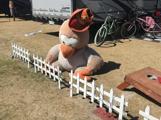 A stuffed bird dressed as a cowboy hung out Saturday in the campgrounds.