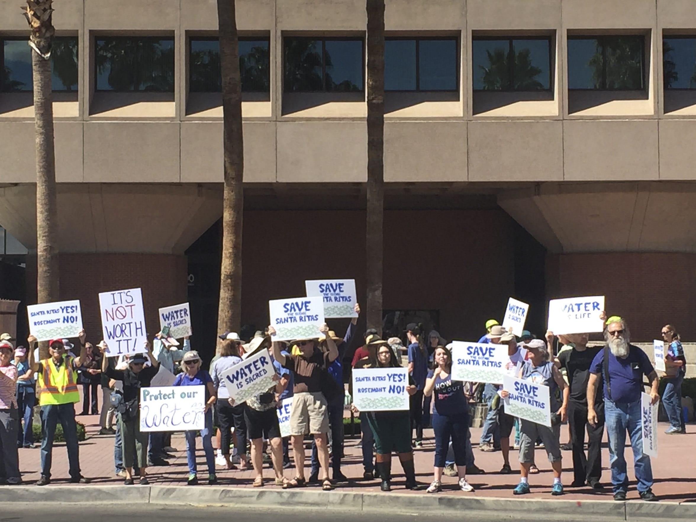 Demonstrators gather outside Tucson Federal Building on April 13, 2019, to protest the planned Rosemont Mine. They fear the mining operation will cause ecological damage to the Santa Rita Mountains and threaten local groundwater.