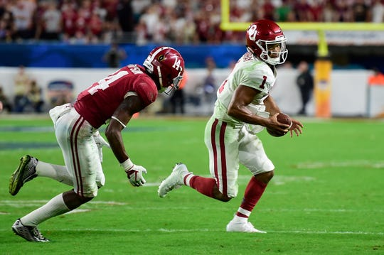 Dec 29, 2018: Oklahoma Sooners quarterback Kyler Murray (1) runs with the ball as Alabama Crimson Tide defensive back Deionte Thompson (14) chases during the second half of the 2018 Orange Bowl college football playoff semifinal game at Hard Rock Stadium.