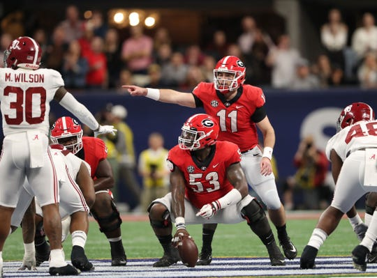 Dec 1, 2018: Georgia Bulldogs quarterback Jake Fromm (11) and center Lamont Gaillard (53) at the line of scrimmage during the SEC championship game against the Alabama Crimson Tide at Mercedes-Benz Stadium.