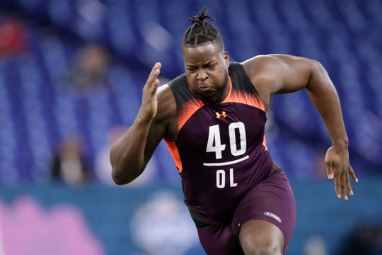 Morgan State offensive lineman Joshua Miles runs a drill at the NFL football scouting combine in Indianapolis, Friday, March 1, 2019.