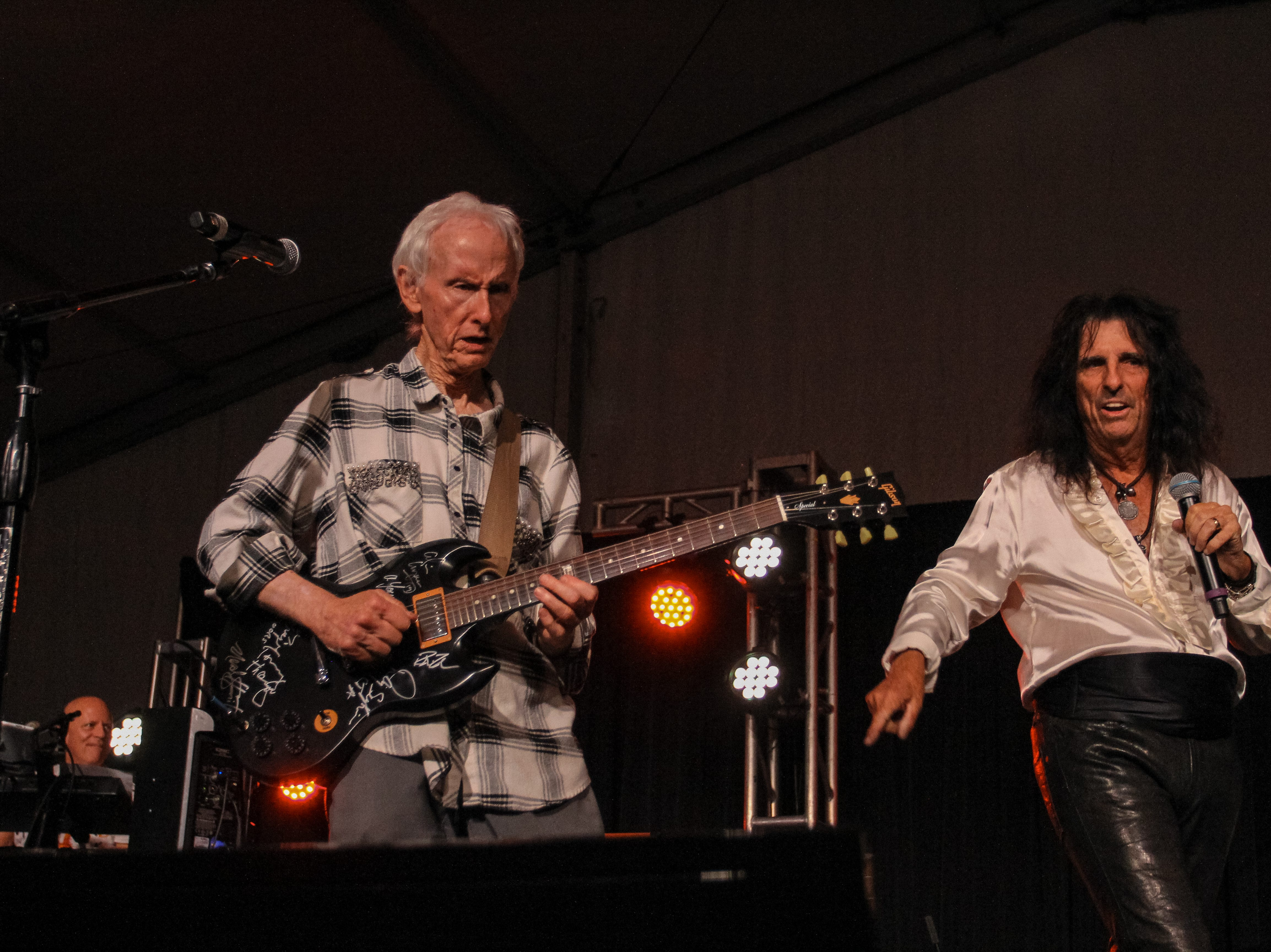 Alice Cooper and Robby Krieger of The Doors perform at Alice Cooper's Rock & Roll Fundraising Bash at the Las Sendas Golf Club in Mesa on April 27, 2019.