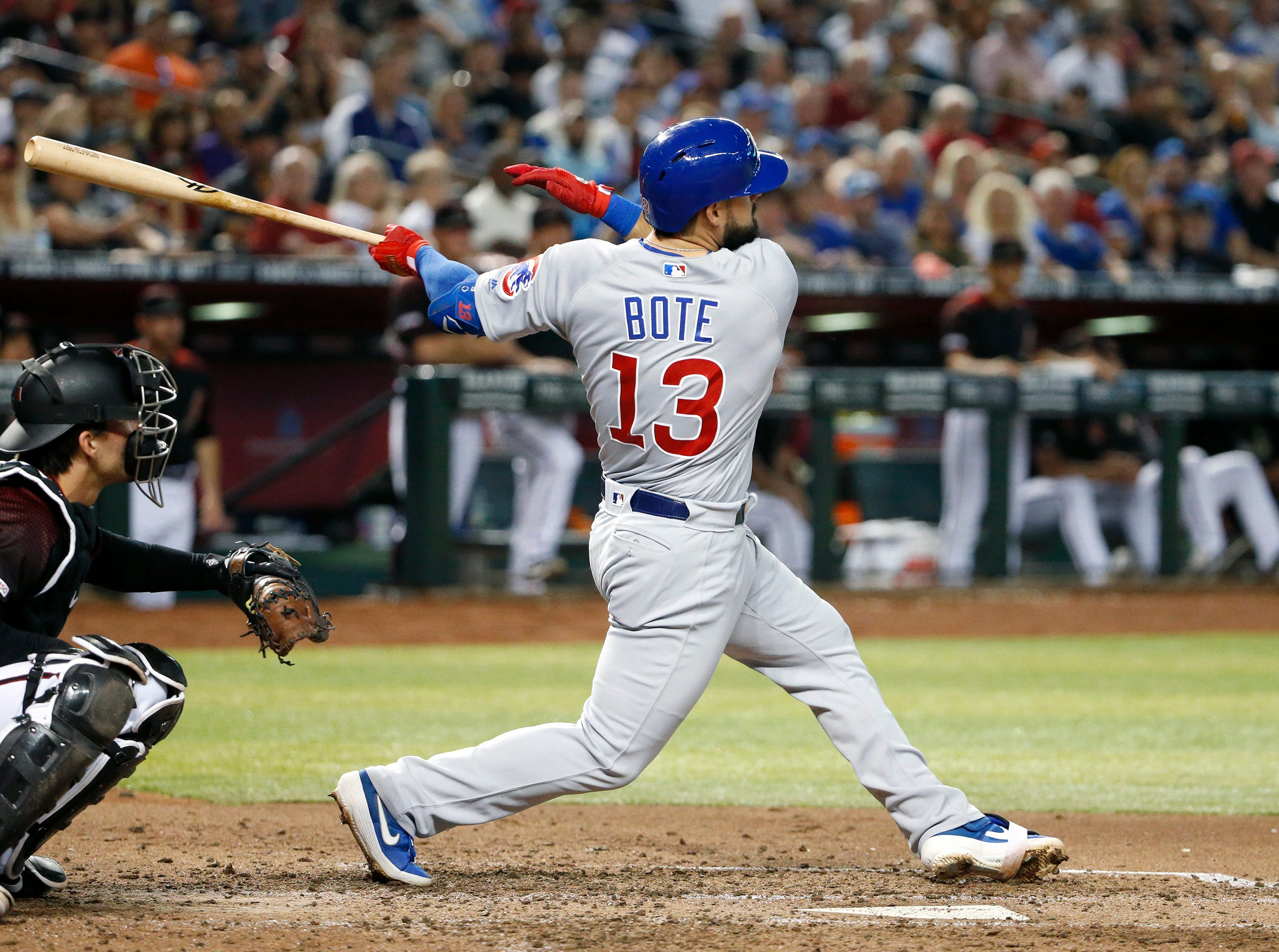 Chicago Cubs' David Bote (13) watches his three-run home run against the Arizona Diamondbacks during the third inning of a baseball game, Saturday, April 27, 2019, in Phoenix. (AP Photo/Ralph Freso)