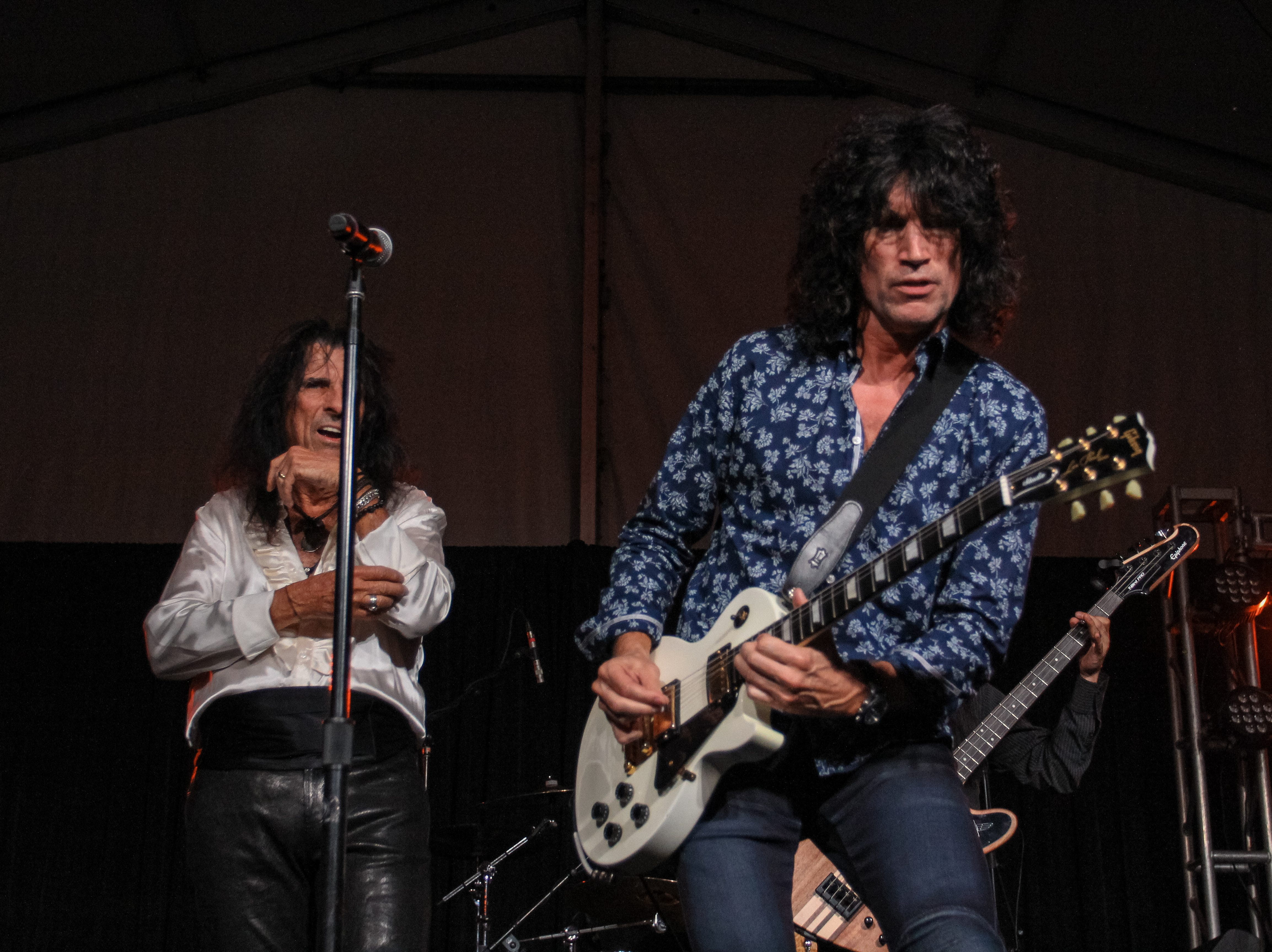 Alice Cooper and Tommy Thayer of Kiss perform at Alice Cooper's Rock & Roll Fundraising Bash at the Las Sendas Golf Club in Mesa on April 27, 2019.