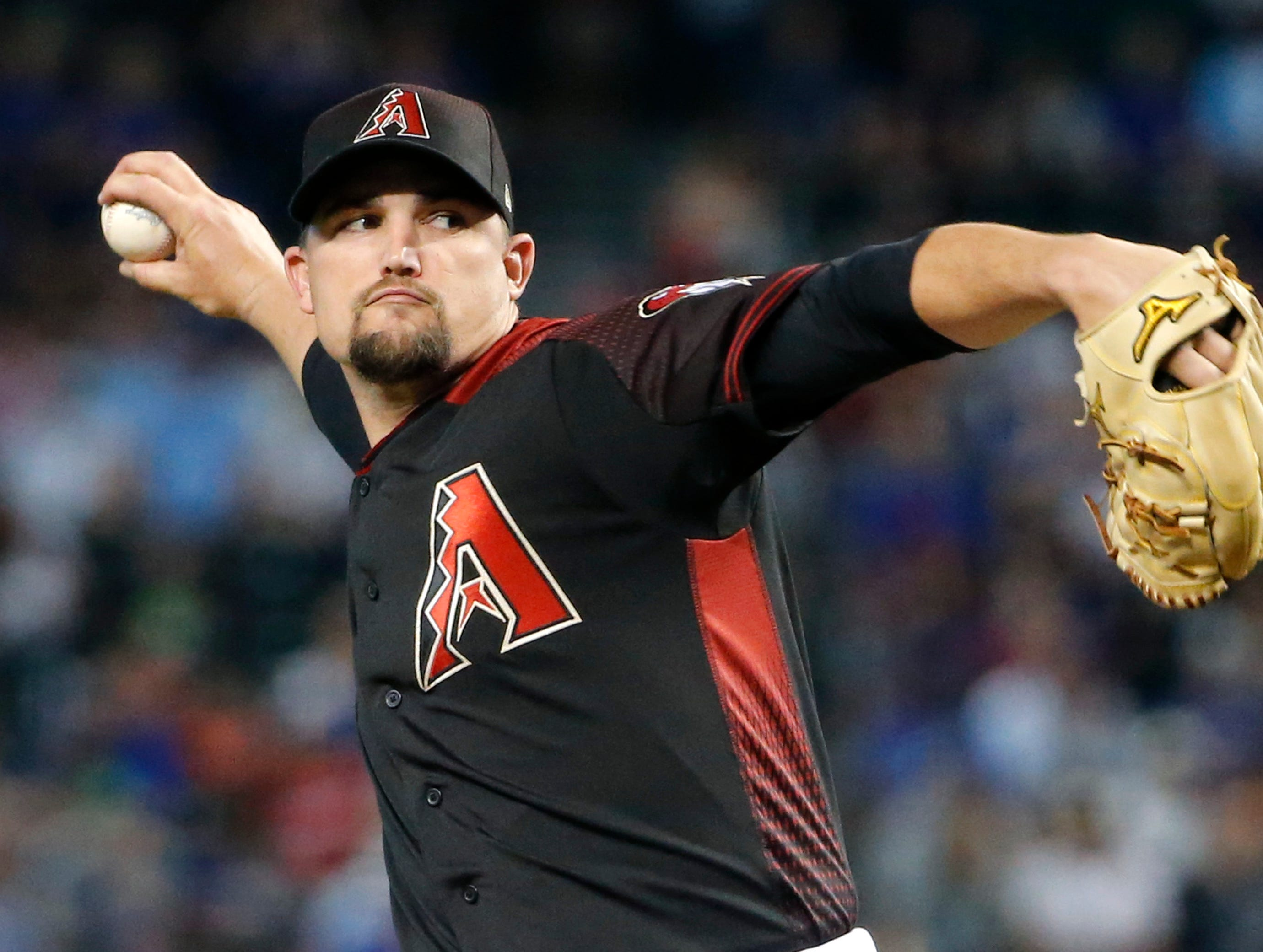Arizona Diamondbacks starting pitcher Zack Godley throws against the Chicago Cubs during the first inning of a baseball game, Saturday, April 27, 2019, in Phoenix. (AP Photo/Ralph Freso)