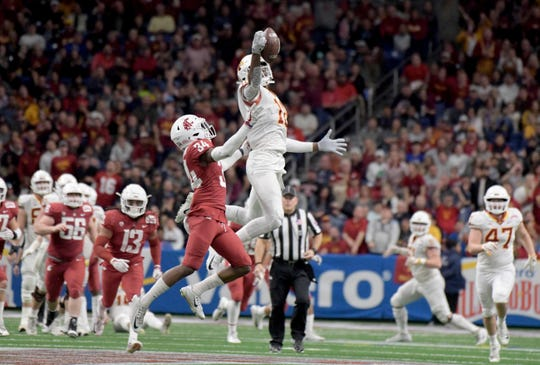 Dec 28, 2018: Iowa State Cyclones wide receiver Hakeem Butler (18) makes a catch in front of Washington State Cougars safety Jalen Thompson (34) during the third quarter in the 2018 Alamo Bowl at Alamodome.
