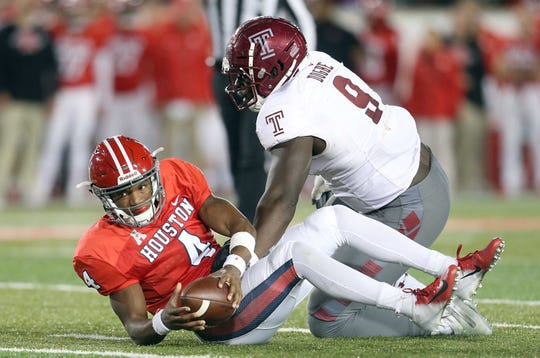 Nov 10, 2018: Houston Cougars quarterback D'Eriq King (4) is sacked by Temple Owls defensive tackle Michael Dogbe (9) in the second half at TDECU Stadium.