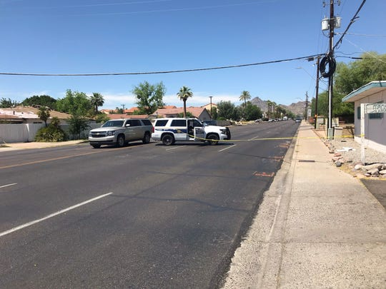 Phoenix police cordon off 32nd street where officers arrested a man suspected of stealing density gauges from his workplace on April 28, 2019.