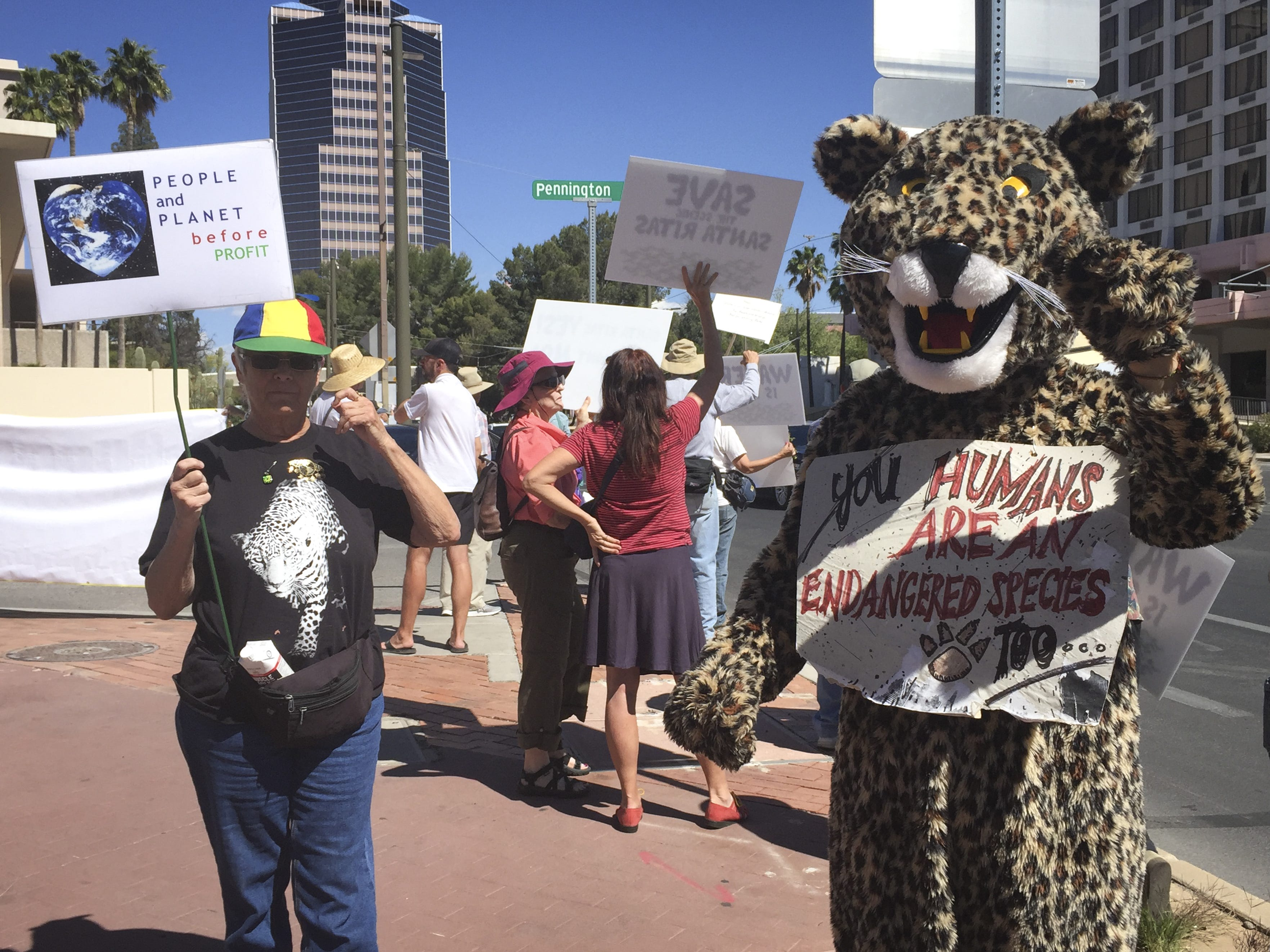 Patagonia resident Carolyn Shafer (left) joins Robert Gay, dressed in a jaguar costume, at a rally outside the Tucson Federal Building on April 13, 2019. Members from Patagonia Area Resource Alliance oppose the planned Rosemont Mine, saying it would threaten local groundwater and habitat range for the endangered jaguar.