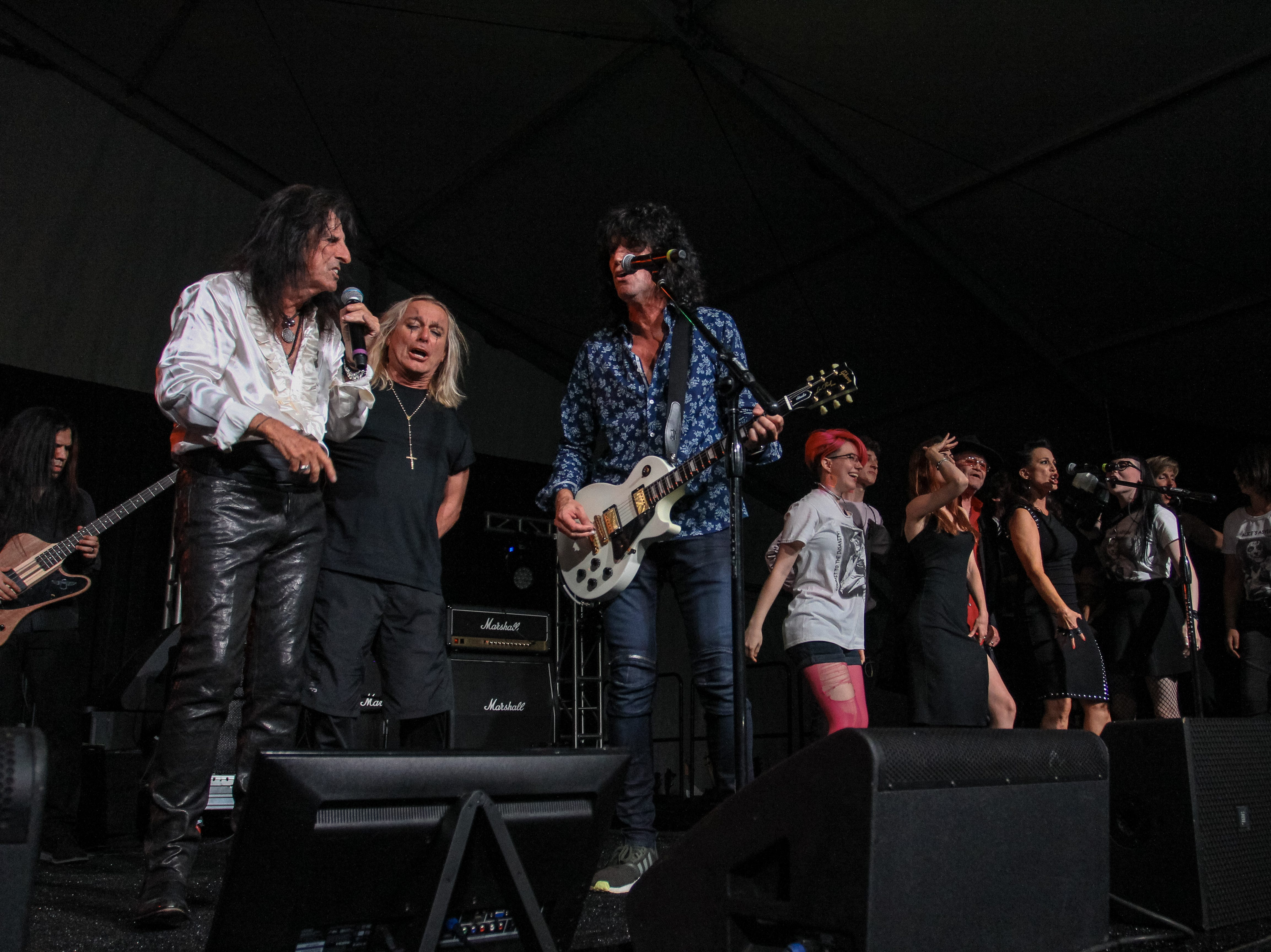 Alice Cooper, Tommy Thayer of Kiss and Robin Zander of Cheap Trick perform at Alice Cooper's Rock & Roll Fundraising Bash at the Las Sendas Golf Club in Mesa on April 27, 2019.