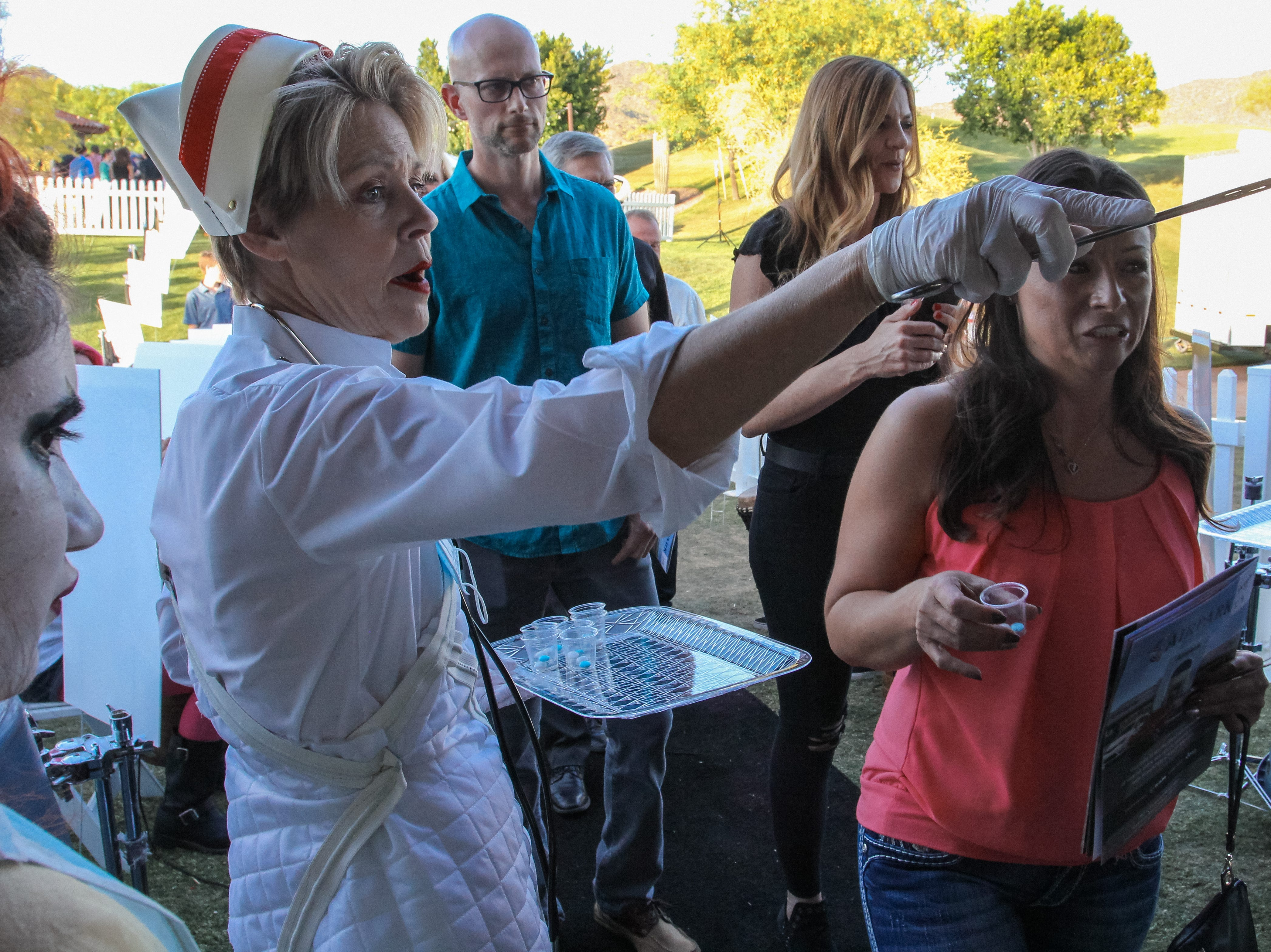 "Employees give ""medicine"" to guests at Alice Cooper's Rock & Roll Fundraising Bash at the Las Sendas Golf Club in Mesa on April 27, 2019."