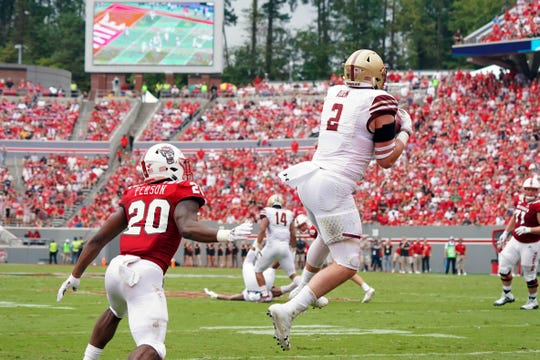 Oct 6, 2018: Boston College Eagles defensive end Zach Allen (2) intercepts a first half pass against North Carolina State Wolfpack running back Ricky Person Jr. (20) at Carter-Finley Stadium.