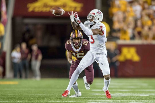 Sep 8, 2018: Fresno State Bulldogs wide receiver KeeSean Johnson (3) catches a pass in the second half as Minnesota Golden Gophers defensive back Coney Durr (16) gets ready to make a tackle in the second half at TCF Bank Stadium.