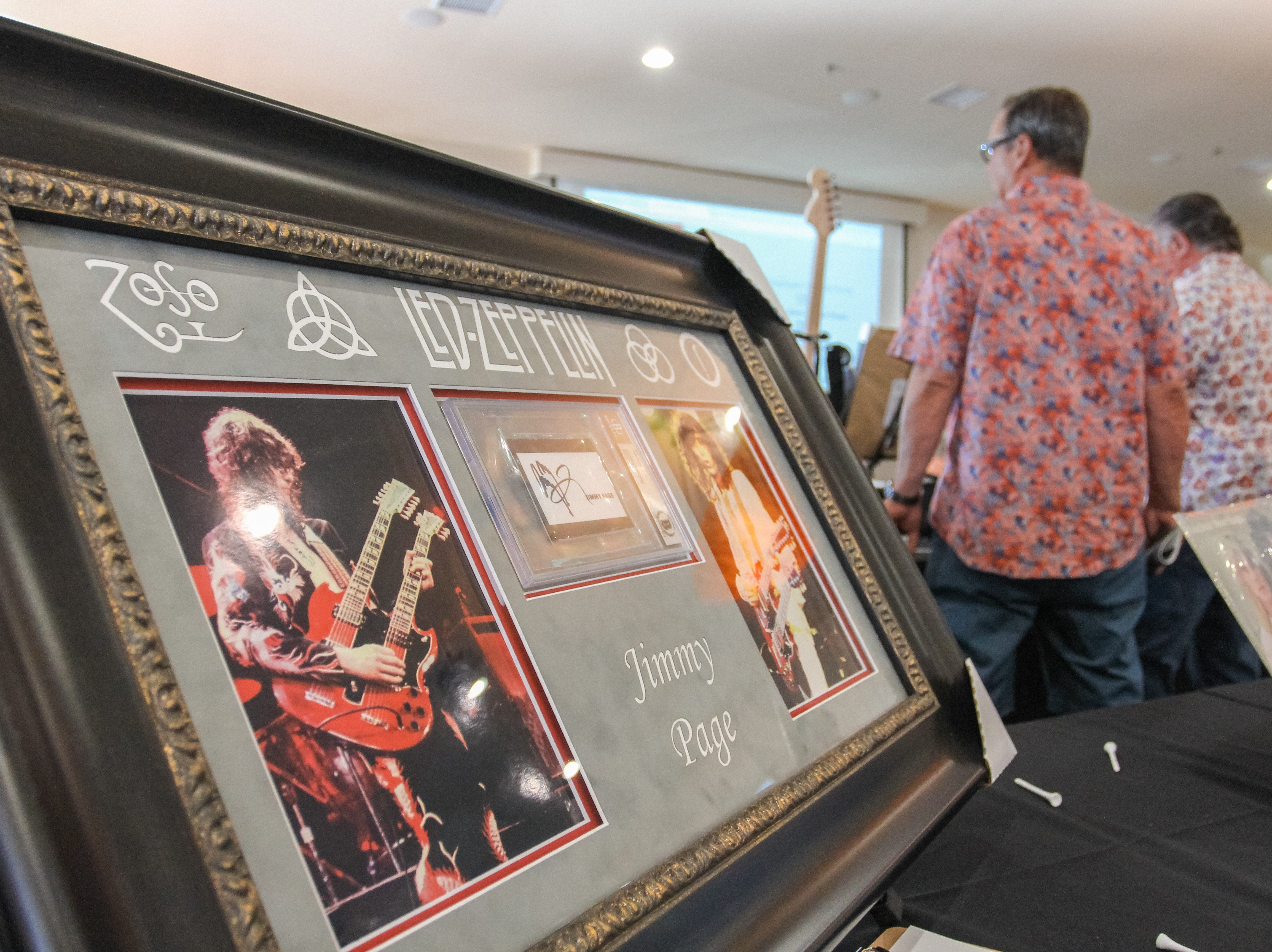 Guests bid on items at Alice Cooper's Rock & Roll Fundraising Bash at the Las Sendas Golf Club in Mesa on April 27, 2019.