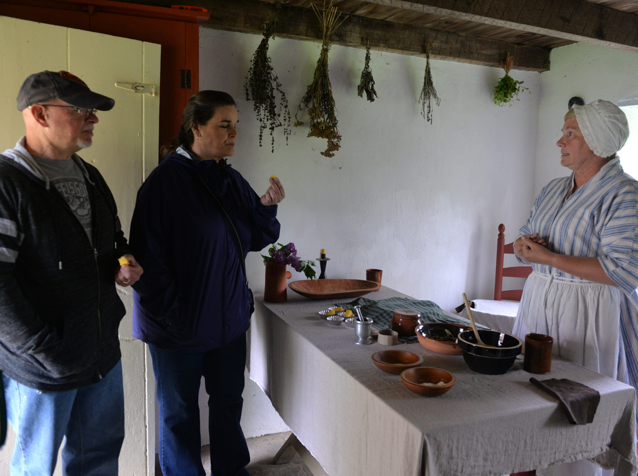 Kim Otto prepares cornbread in the springhouse during Making Sense of History, a special living history program that focused on the senses, held at The Conrad Weiser Homestead at Womelsdorf, Pa on Sunday, April 28, 2019.