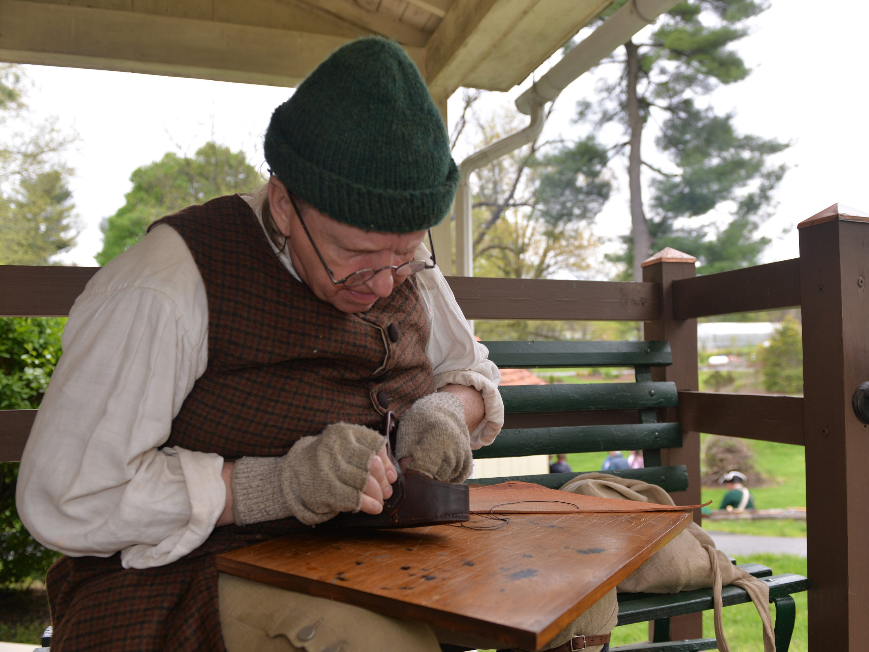 Brian Beamesderfer portrayed a cordwainer and discussed his trade while crafting a leather key basket at The Conrad Weiser Homestead at Womelsdorf, PA during the  'Making Sense of History' living history program held on Sunday, April 28, 2019.