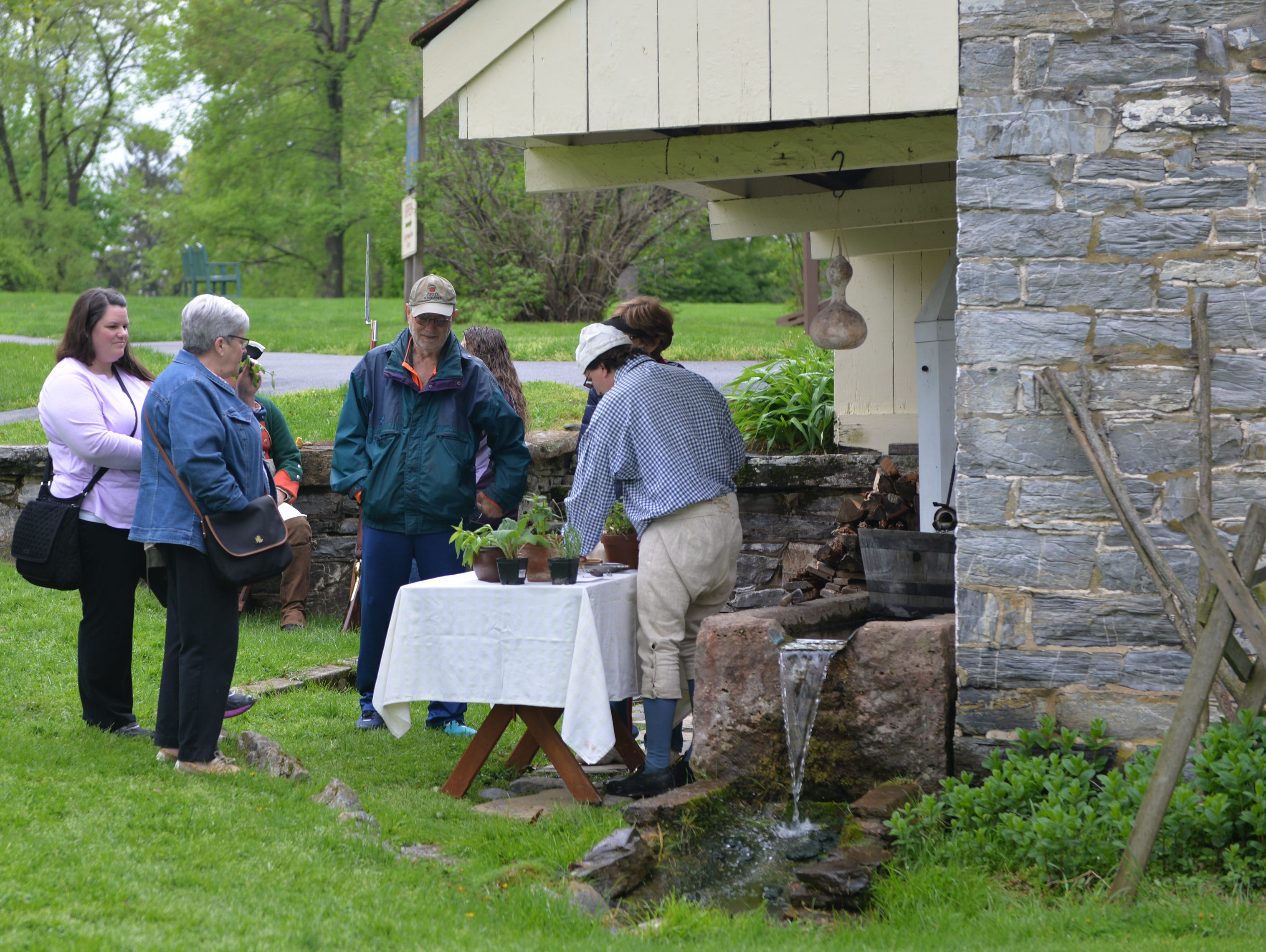 Next to the springhouse Dave Sonnen invited visitors to touch and smell the fragrant herbs grown in the Homestead garden during 'Making Sense of History' held at The Conrad Weiser Homestead at Womelsdorf, Pa on Sunday, April 28, 2019.