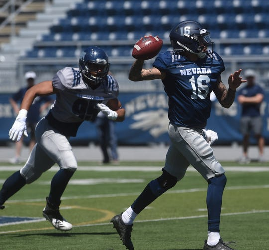 Quarterback Malik Henry looks downfield during Nevada's annual Silver & Blue Spring Game on Saturday.
