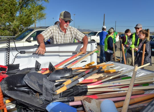 Fernley General Services Parks foreman Ray Lowrey arranges tools for volunteers to use.