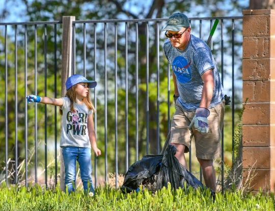 Brynne Bassett, 4, and her father Scott Bassett, of Fernley, help clean up Ponderosa Park.