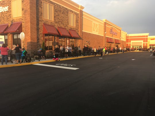 An estimated 2,500 people waited for the opening of the first Wegmans in Virginia Beach, Virginia. It's the 99th store in the Wegmans chain.