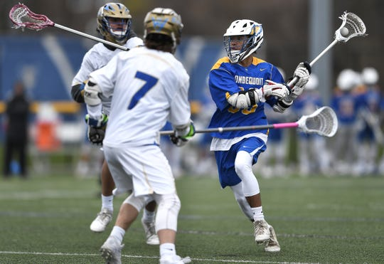 Irondequoit's Yavin Stefano, right, winds up a shot on goal during a game at Webster Schroeder High School, Saturday, April 27, 2019. Irondequoit beat Webster Schroeder 13-9.