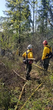 More than 30 firefighters worked to extinguish a brush fire Saturday that started when a homeowner was burning weeds.