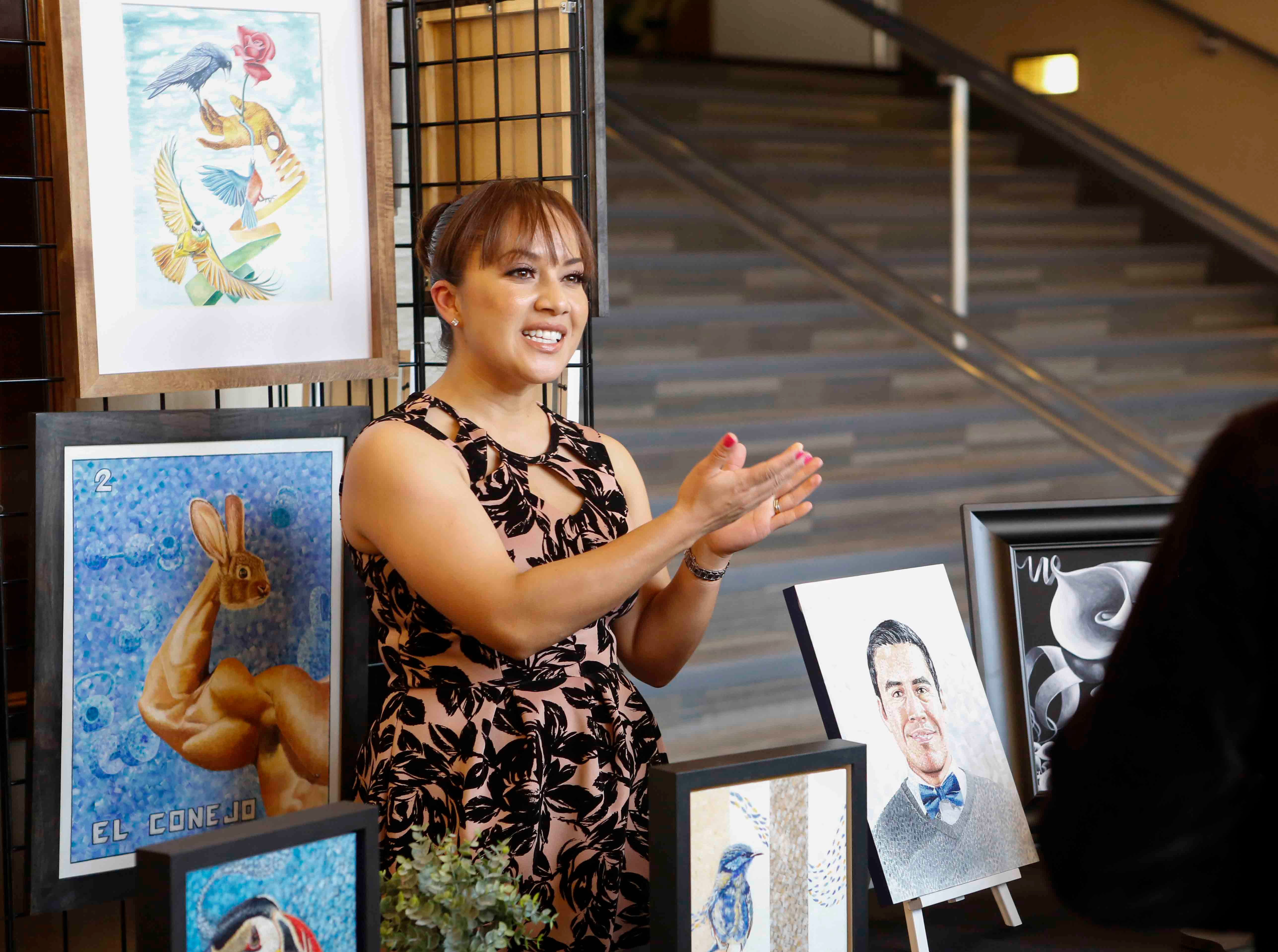 A visual artist talks about the work of Jesús Núñez on display during the 12th annual Noche Bohemia, a cultural event promoting dance, visual art, music and poetry at Sherwood Hall on Saturday, April 27, 2019 in Salinas, Calif.