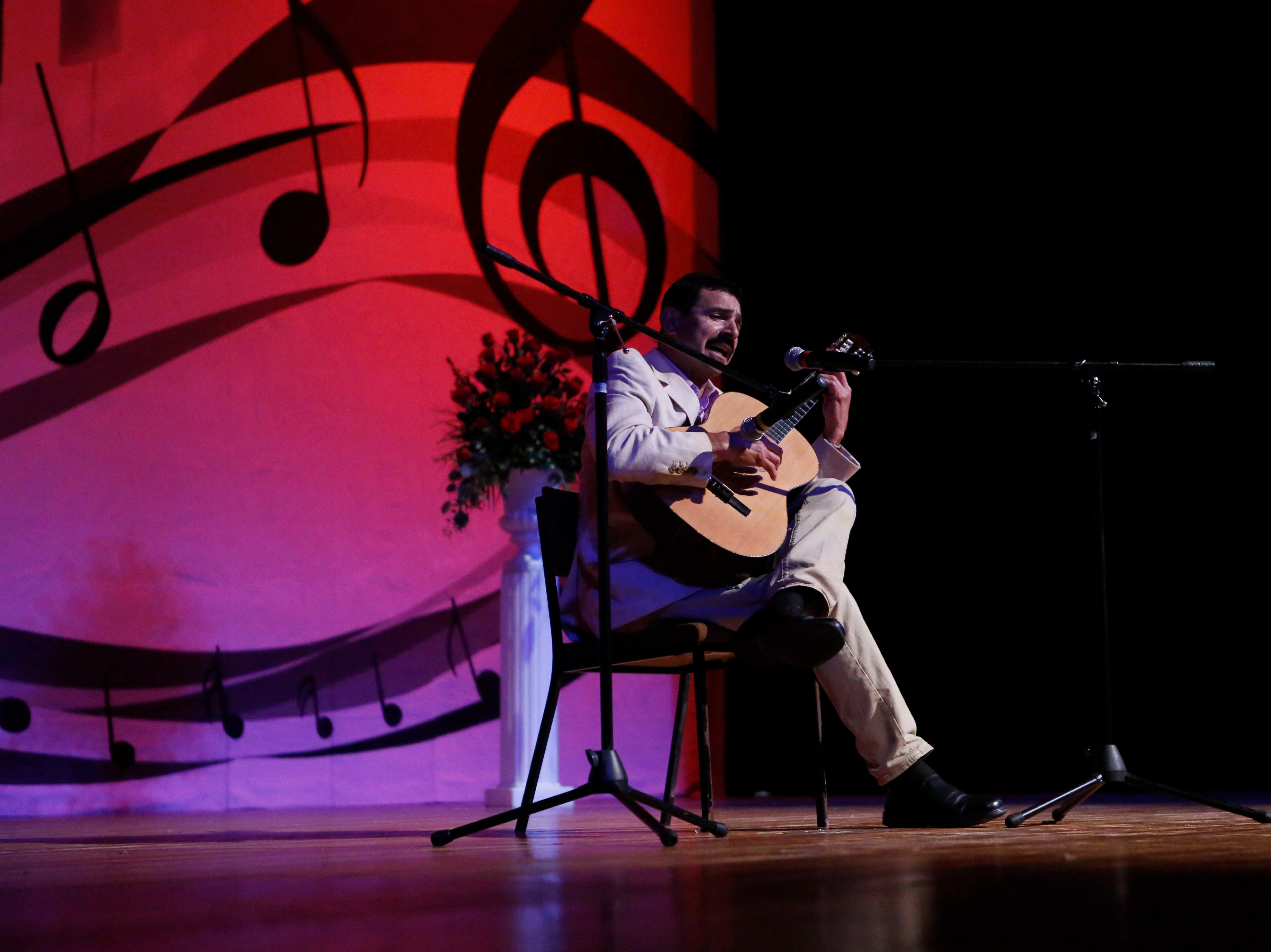 Francisco Penuelas sings as he plays his guitar during the 12th annual Noche Bohemia at Sherwood Hall on Saturday, April 27, 2019 in Salinas, Calif.