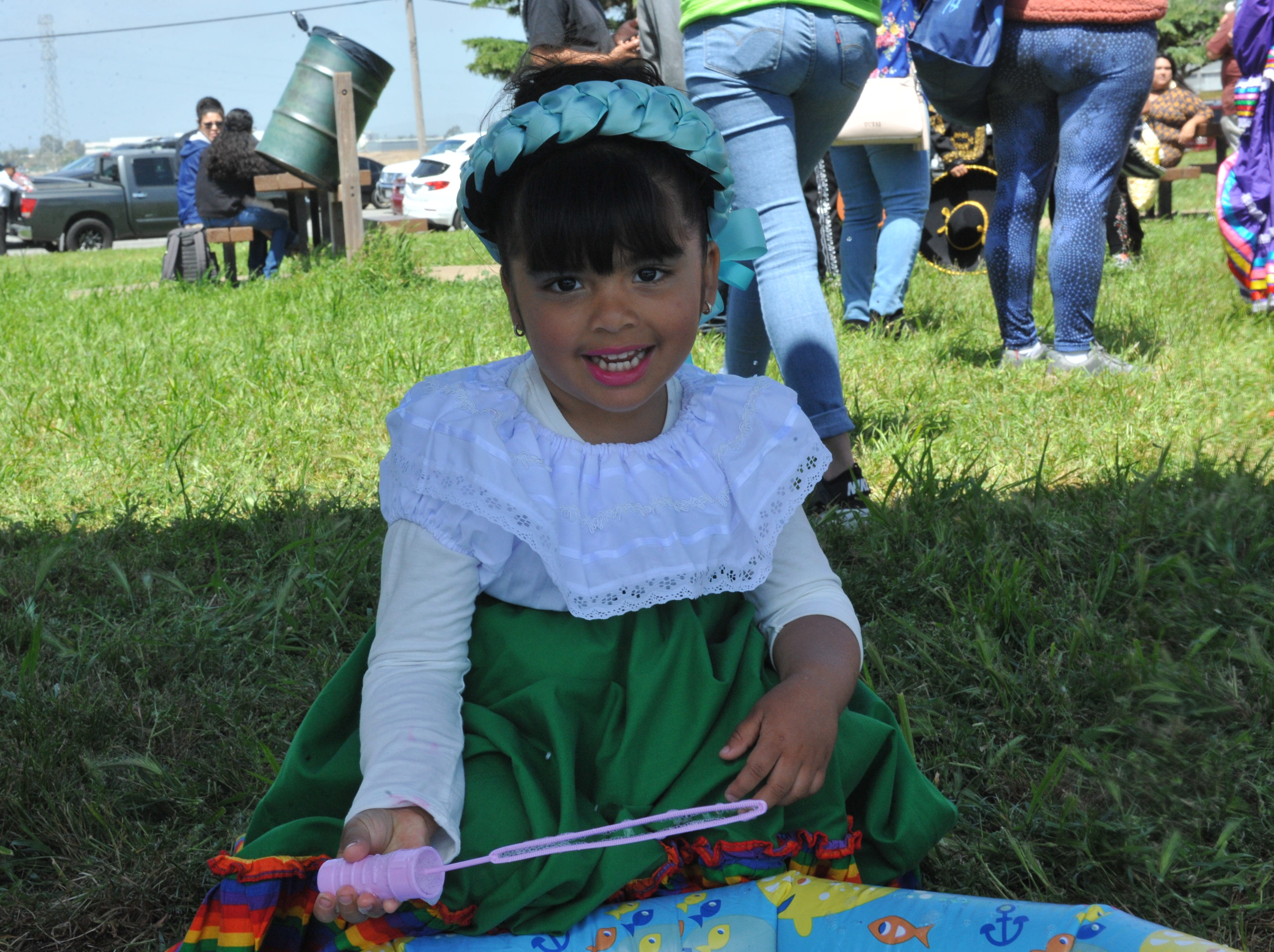 Valeria Hernández Alcala, 3, plays with bubbles prior to her afternoon dance performance at the Salinas Día Del Niño on April 28, 2019.