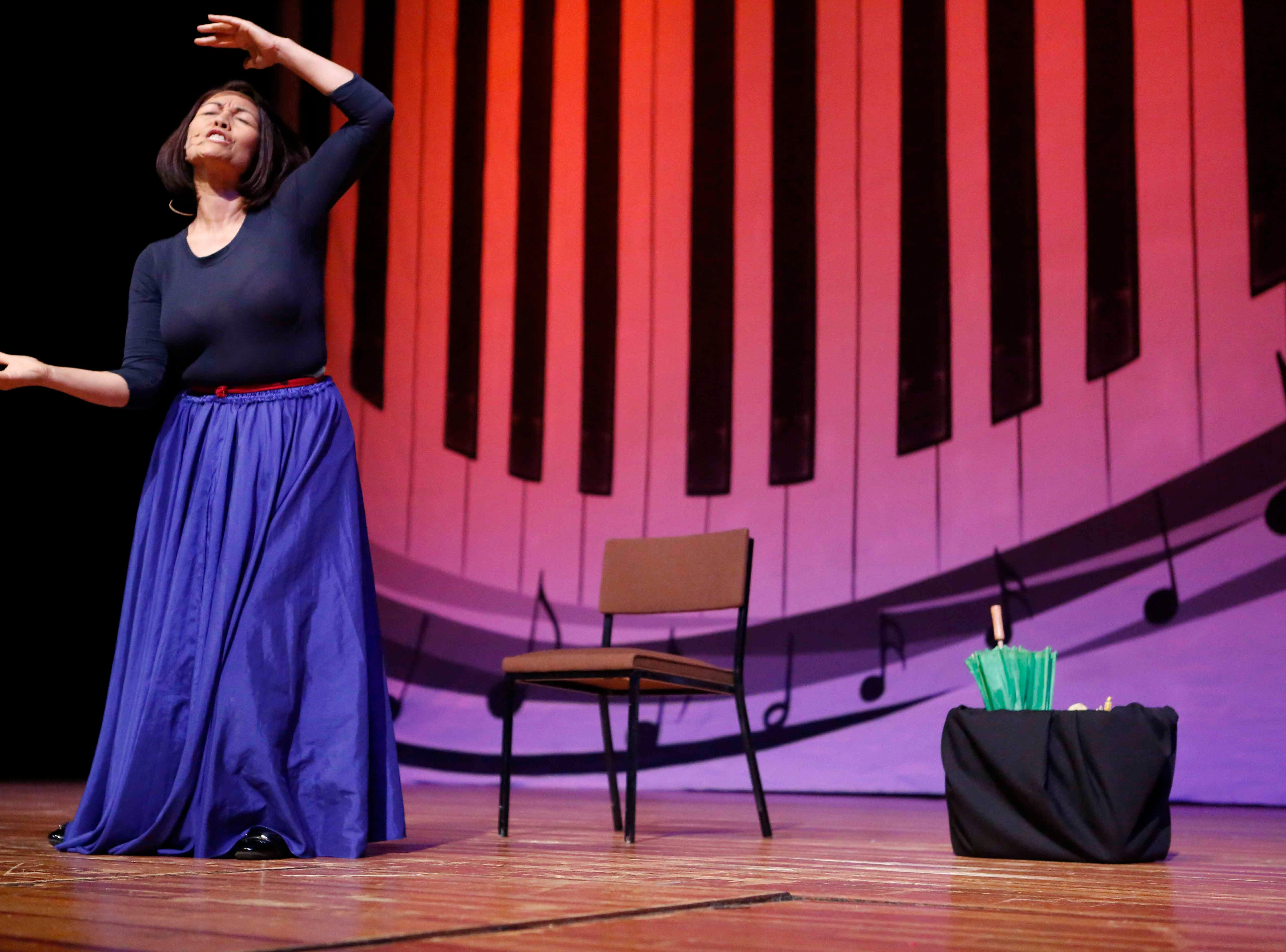 Umbelina Martinez performs a dramatic act during the 12th annual Noche Bohemia at Sherwood Hall on Saturday, April 27, 2019 in Salinas, Calif.